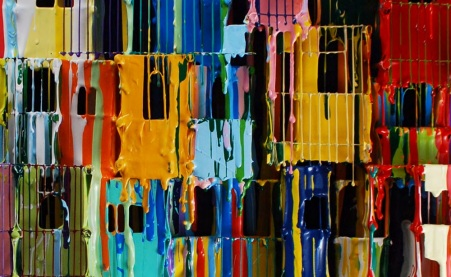 Russell West. Unnamed artwork. Little boxes made of wire and metal are crammed together in a manner of Kowloon Walled City. The paint then is applied to the houses and the artist has let the paint drip, allowing the paint to run to other boxes or houses and mix with other colours.